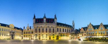 BEL1853AW Belgium, West Flanders (Vlaanderen), Bruges (Brugge). Stadhuis van Brugge city hall and Brugse Vrije on Burg Square at dusk.