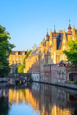 BEL1873AWRF Belgium, West Flanders (Vlaanderen), Bruges (Brugge). Brugse Vrije and buildings along the Groenerei canal at dawn.