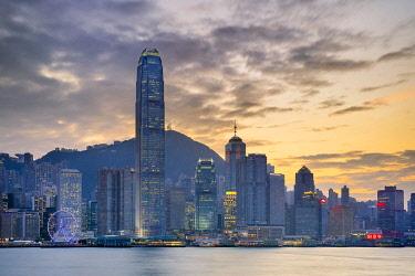 CH11958AW Hong Kong skyline, skyscrapers on Hong Kong Island skyline at sunset seen from Tsim Sha Tsui, Kowloon, Hong Kong, China