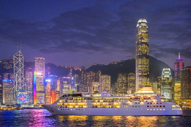 CH11961AW Cruisliner Silversea passing by Hong Kong Island skyline on Victoria Harbor at night, Hong Kong, China