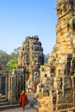 CMB1661AW A monk walk through Prasat Bayon temple ruins, Angkor Thom, UNESCO World Heritage Site, Siem Reap Province, Cambodia