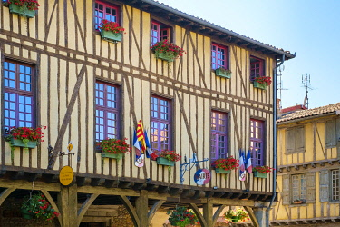FRA11373AWRF Mirepoix town hall (Mairie) half-timbered building on Place de Couverts in bastide town of Mirepoix, Ariège, Midi-Pyrénées, France.