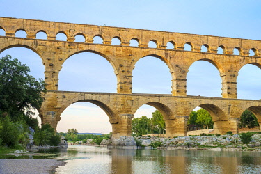 FRA11394AWRF Pont du Gard Roman aqueduct over Gard River at sunset, Gard Department, Languedoc-Roussillon, France