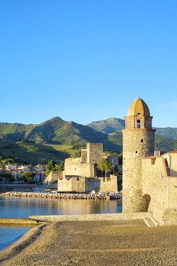 FRA11130AW Clocktower of Notre-Dame-des-Anges church and the Château Royal de Collioure, Collioure, Pyrénées-Orientales, Languedoc-Roussillon, France.
