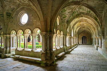 FRA11137AW Romanesque cloisters at Abbaye de Fontfroide, Aude Department, Languedoc-Roussillon, France.
