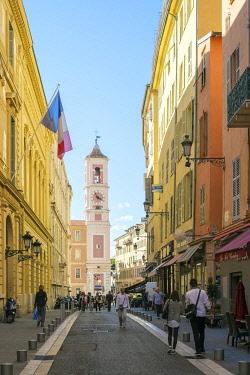 FRA11168AW View of Rue de la Préfecture towards clocktower on Place du Palais de Justice. Vieille Ville (Old Town), Nice, Alpes-Maritimes, Provence-Alpes-Côte d'Azur, France.