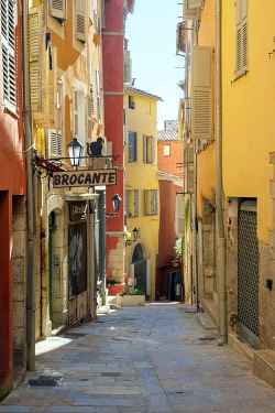 FRA11171AW Colorful buildings and Brocante antique dealer's sign on sunny afternoon in Grasse, Alpes-Maritimes, Provence-Alpes-Côte d'Azur, France.