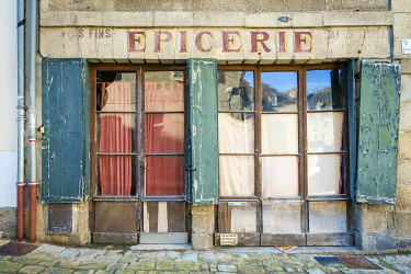 FRA11175AW Abandoned storefront vintage painted sign of old Epicerie market store, Aubusson, La Creuse Department, Limousin, France.