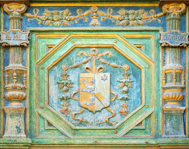 FRA11194AW Carved painted coat of arms of Katherine Briçonnet on wooden front door of Château de Chenonceau castle, Chenonceaux, Indre-et-Loire, Centre, France.