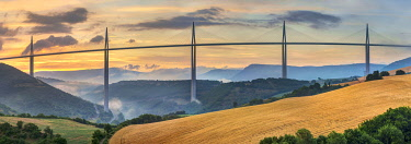 FRA11279AW Viaduc de Millau bridge over Tarn river valley at sunrise, Millau, Aveyron Department, Midi-Pyrénées, France