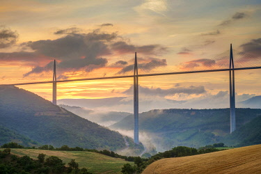 FRA11281AW Viaduc de Millau bridge over Tarn river valley at sunrise, Millau, Aveyron Department, Midi-Pyrénées, France