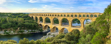 FRA11288AW Pont du Gard Roman aqueduct over Gard River in late afternoon, Gard Department, Languedoc-Roussillon, France