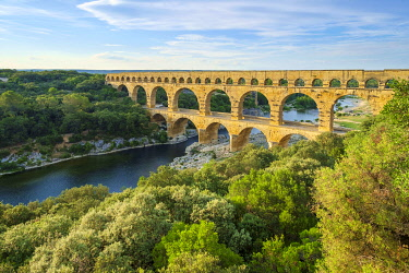 FRA11289AW Pont du Gard Roman aqueduct over Gard River in late afternoon, Gard Department, Languedoc-Roussillon, France
