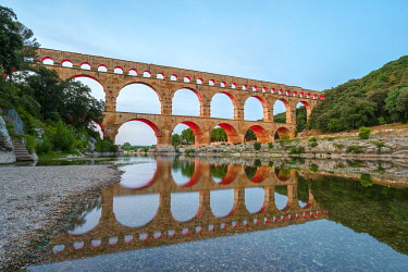 FRA11290AW Pont du Gard Roman aqueduct over Gard River at dusk, Gard Department, Languedoc-Roussillon, France