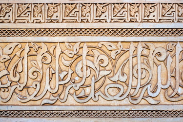 MOR2560AWRF Morocco, Marrakech-Safi (Marrakesh-Tensift-El Haouz) region, Marrakesh. Carved plaster arabic calligraphy, Ben Youssef Madrasa, 16th century Islamic college.