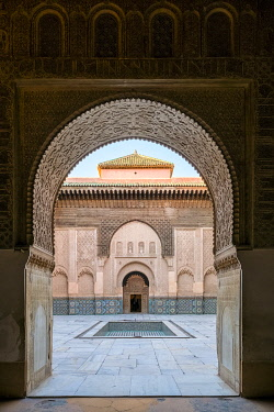 MOR2552AW Morocco, Marrakech-Safi (Marrakesh-Tensift-El Haouz) region, Marrakesh. Archway leading to the courtyard of Ben Youssef Madrasa, 16th century Islamic college.