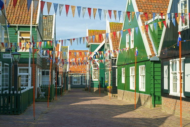 NLD972AW Streets of Marken decorated  for Koningsdag, or King's Day, with flags of Dutch national colors, Marken, North Holland, Netherlands