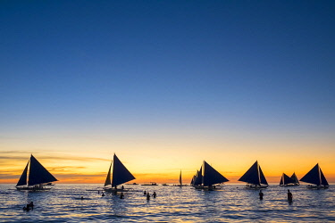 PHI1647AWRF Sailboats at sunset on White Beach, Boracay Island, Aklan Province, Western Visayas, Philippines