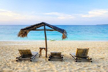 PHI1648AWRF Beach chairs and shade umbrella on Puka Shell Beach, Boracay Island, Aklan Province, Western Visayas, Philippines