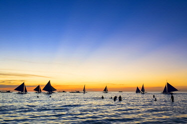 PHI1538AW Sailboats at sunset on White Beach, Boracay Island, Aklan Province, Western Visayas, Philippines