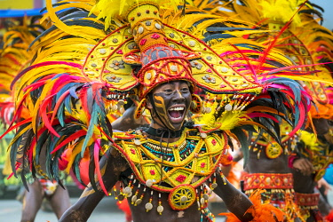 PHI1643AW A member of Tribu Panayanon of Iloilo City National High School, Molo, Iloilo City reacts during the 2015 Dinagyang Festival, Iloilo City, Western Visayas, Philippines