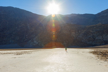 USA14475AW Tourist exploring the salt flats at Badwater Basin at Sunrise in Death Valley National Park, California, United States. (MR)