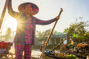 VIT1634AW A Vietnamese woman paddles her boat at Phong Dien floating market, Phong Äiá�n District, Cá��n Thơ, Mekong Delta, Vietnam