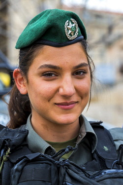 ISR1676AW Border patrol police woman  at a checkpoint in Jerusalem, Isreal.