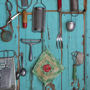 US27BJY0150 USA, Montana, Missoula. Old fashioned kitchen implements displayed on weathered door