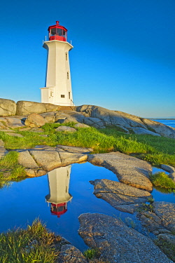 CN07BJY0100 Canada, Nova Scotia. Peggy's Cove Lighthouse reflection in water
