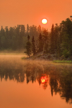 CN08BJY0371 Canada, Ontario, Kenora. Reflections in Isabel Lake at sunrise