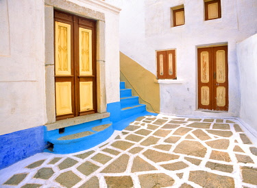 EU12BJY0012 Greece, Symi. Doors to courtyard and stairway of house