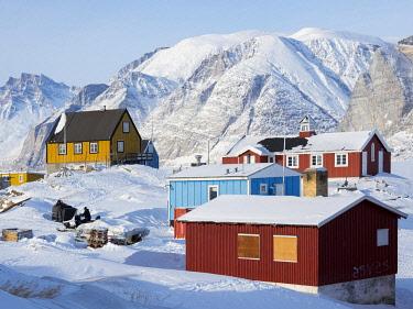 GR01MZW1376 Saatut fishing village during winter in the Uummannaq Fjord, north of the polar circle. Greenland, Denmark.
