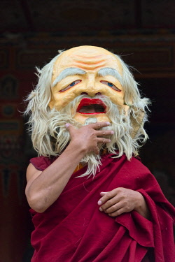Tibetan monk wearing mask at a Buddhist festival, Juli Temple, Xinduqiao, western Sichuan, China