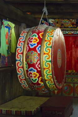 AS07KSU2170 Drum in the prayer room in Zhuokeji Headman's Village, Ngawa Tibetan and Qiang Autonomous Prefecture, western Sichuan, China