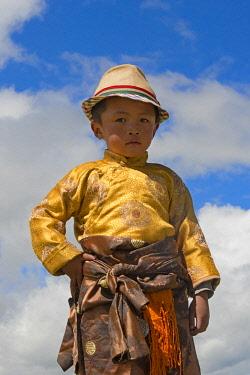 AS07KSU2382 Tibetan boy in traditional clothing at Horse Race Festival, Litang, western Sichuan, China
