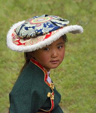 AS07KSU2389 Tibetan girl in traditional clothing, Xinduqiao, western Sichuan, China