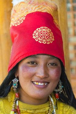 AS07KSU2463 Tibetan woman in traditional clothing, Litang, western Sichuan, China