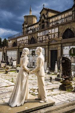ITA13962 Italy, Florence.  Sculpture of a couple adorns their tomb in Porte Sante at San Miniato al Monte