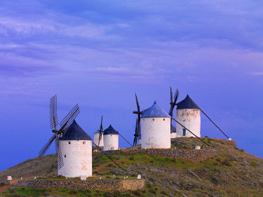 SPA9372AWRF Spain, Castile, La Mancha, Consuegra, Windmills at dusk