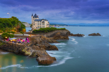 FRA11421AW France, Aquitaine, Pyrenees Atlantiques, Biarritz. Old mansion on the cliffs at dusk