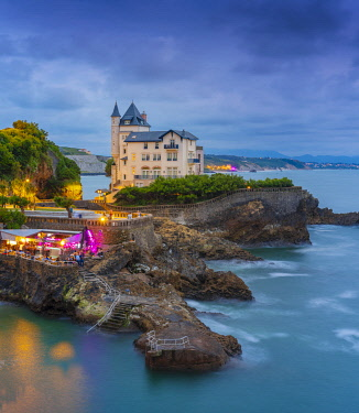 FRA11422AW France, Aquitaine, Pyrenees Atlantiques, Biarritz. Old mansion on the cliffs at dusk