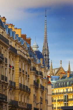 FRA11449AW France, Paris, Notre Dame Cathedral, spire above rooftops