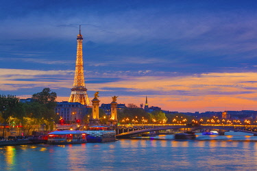 FRA11462AW France, Paris, Eiffel Tower illuminated at night and river Seine