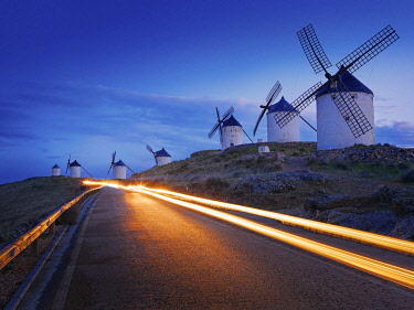 SPA9316AW Spain, Castile, La Mancha, Consuegra, Windmills at dusk