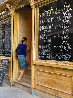 SPA9331AW Spain, Madrid, Woman entering cafe(MR)