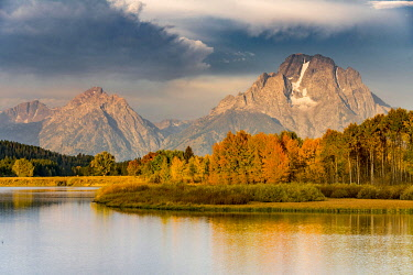 IBXMMW04848749 Mount Moran reflected in Snake River, morning mood at Oxbow Bend, autumn trees and Grand Teton Range, Grand Teton National Park, Wyoming, USA, North America