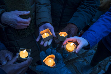 IBXMZC04861469 Hands holding devotional candles at dusk, Bavaria, Germany, Europe
