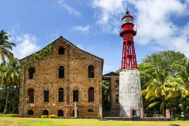 IBXRUN04870368 Lighthouse, former political imprisonment on Devils island, Iles du Salut, French Guiana, South America