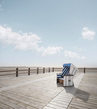 IBXRWI04864855 Single blue-white beach chair stands on beach chair plateau at the wide beach of Sankt Peter-Ording, Nordfriesland, Schleswig-Holstein, Germany, Europe